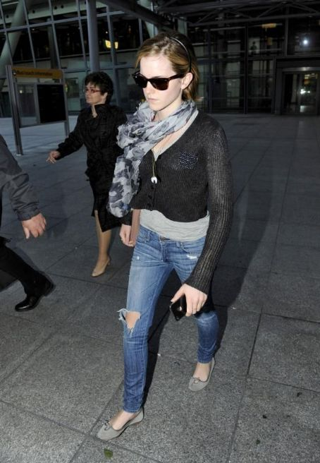 Emma Watson arrives in London, England on a flight from New York on June 15, 2012