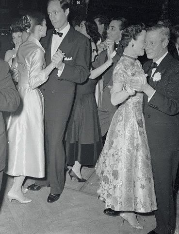 Duchess of Windsor - The couple on the dance floor of the Paris night club, Lido.  Audrey Hepburn and Mel Ferrer dance just off to their left side, 1955.