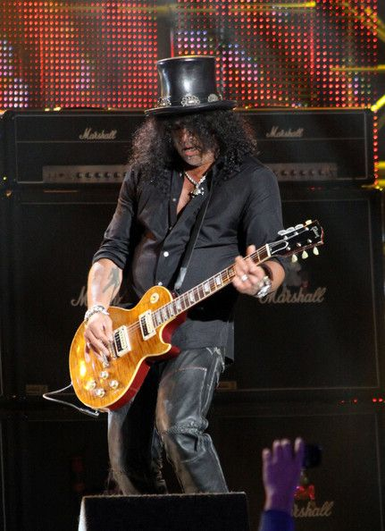 Rock guitarist Slash is seen performing live while filming a television show in Hollywood